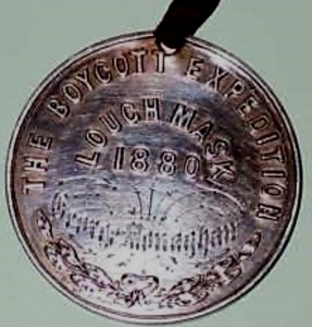 One side of George Monaghans 'Boycott' Medal, inscribed with his name